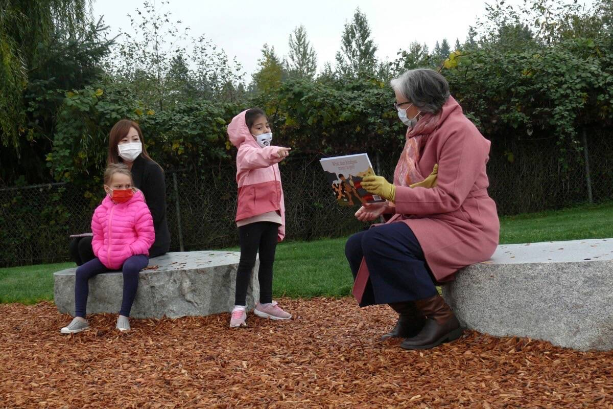 Minister of State for Child Care Katrina Chen (left) and Education Minister Jennifer Whiteside read to children after child care announcement in Langley, Oct. 18, 2021. (Dan Ferguson/Langley Advance Times)