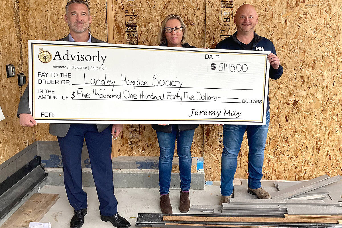 Advisorly CEO Jeremy May (left) and supporter Lyle MacDougall presented a cheque to Langley hospice's Shannon Todd Booth. (Advisorly/Special to Langley Advance Times)