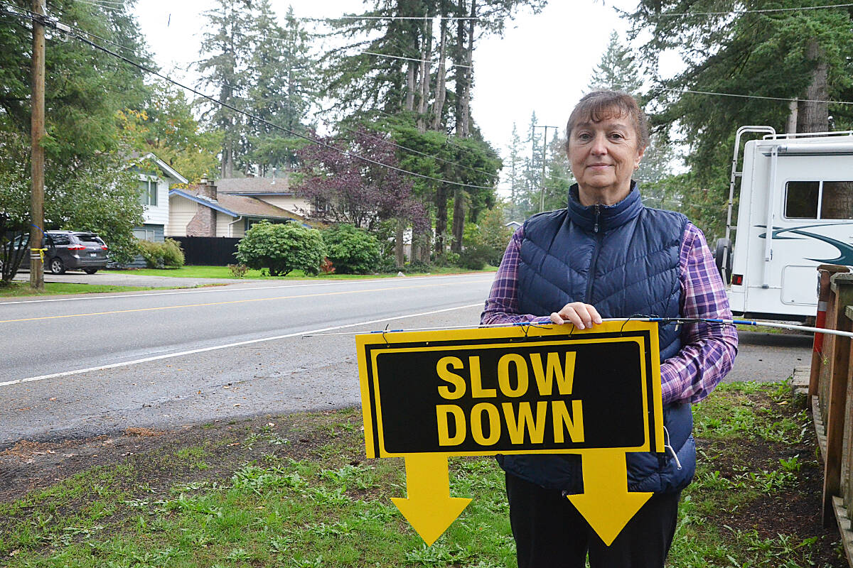 Dolores Peters has signs calling for people to slow down on her 42nd Avenue home. She's hoping the Township will try traffic calming measures for the street. (Matthew Claxton/Langley Advance Times)