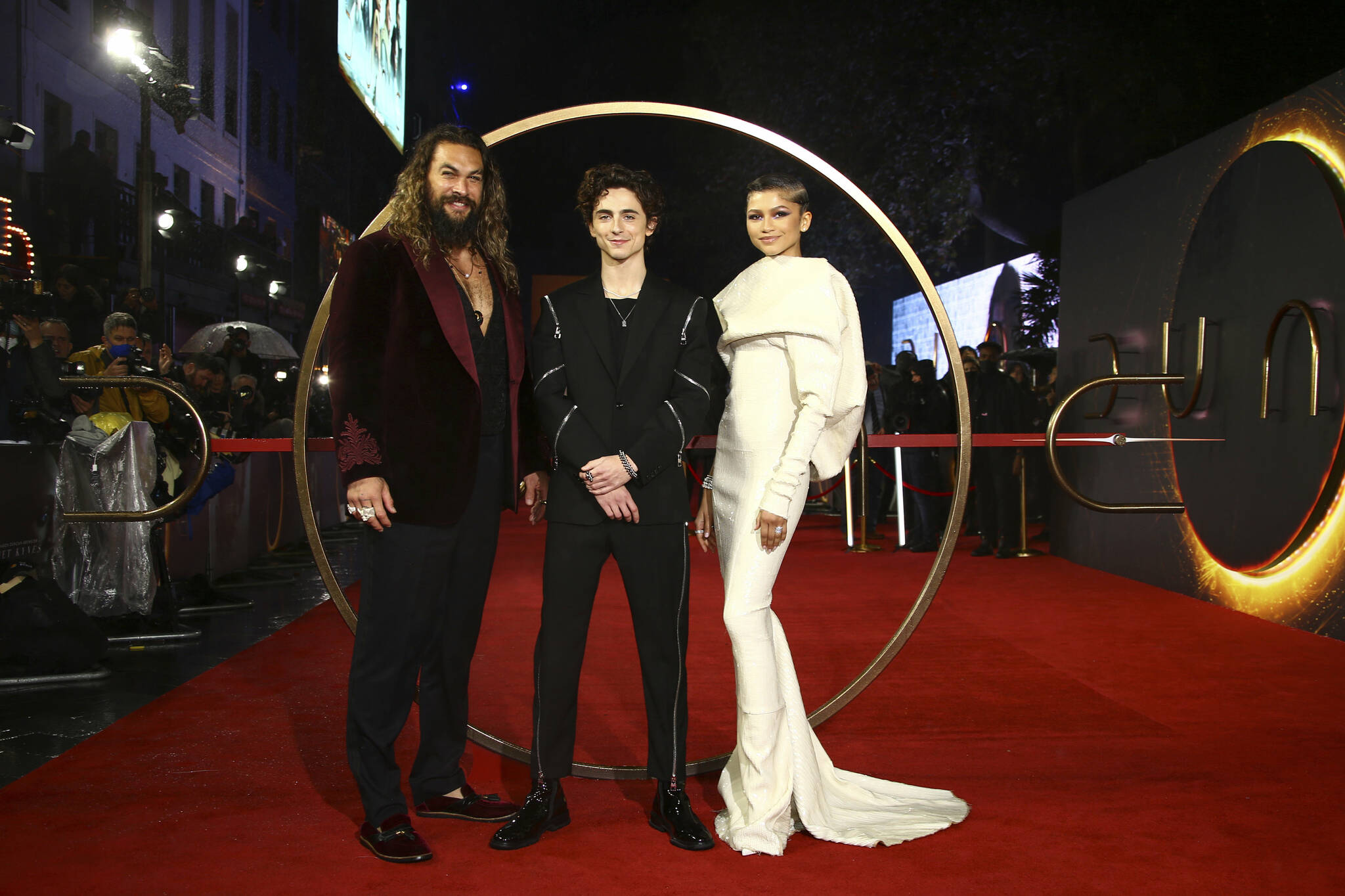 Jason Momoa, from left, Timothee Chalamet, and Zendaya pose for photographers upon arrival at the premiere of the film 'Dune' on Monday, Oct. 18, 2021 in London. (Photo by Joel C Ryan/Invision/AP)