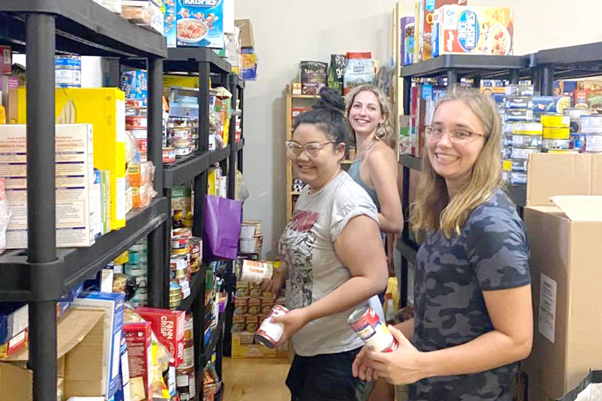 Pamelina Chang, Nicole Lanki and Bethany Jackson recently visited the Siska Indian Band where they helped organize donations at the town hall, which currently serves as a food bank. (Special to Langley Advance Times)