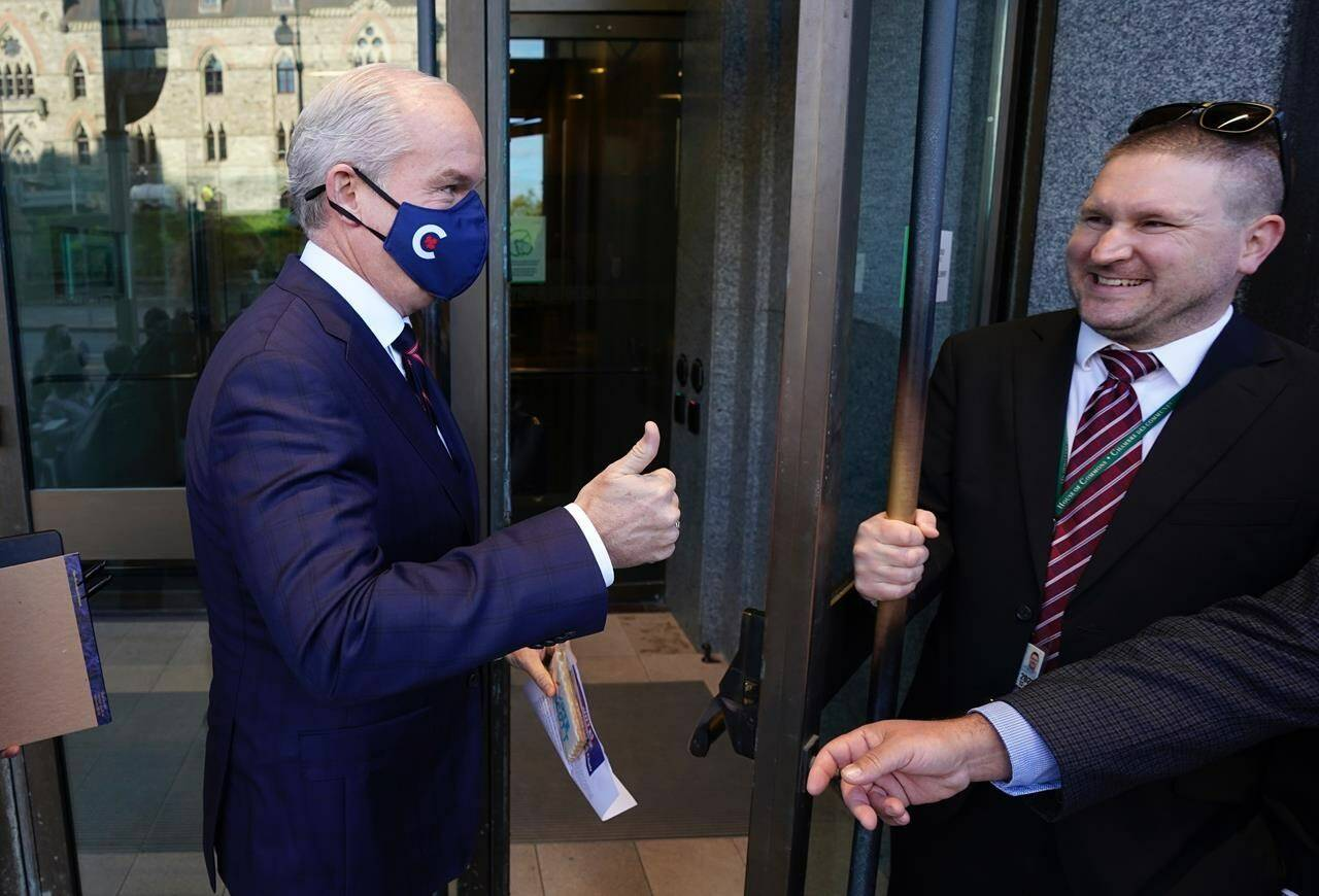 Conservative Leader Erin O'Toole gives a thumbs up as he enters the building for the first Conservative caucus since the federal election, Tuesday, Oct.5, 2021 in Ottawa. THE CANADIAN PRESS/Adrian Wyld