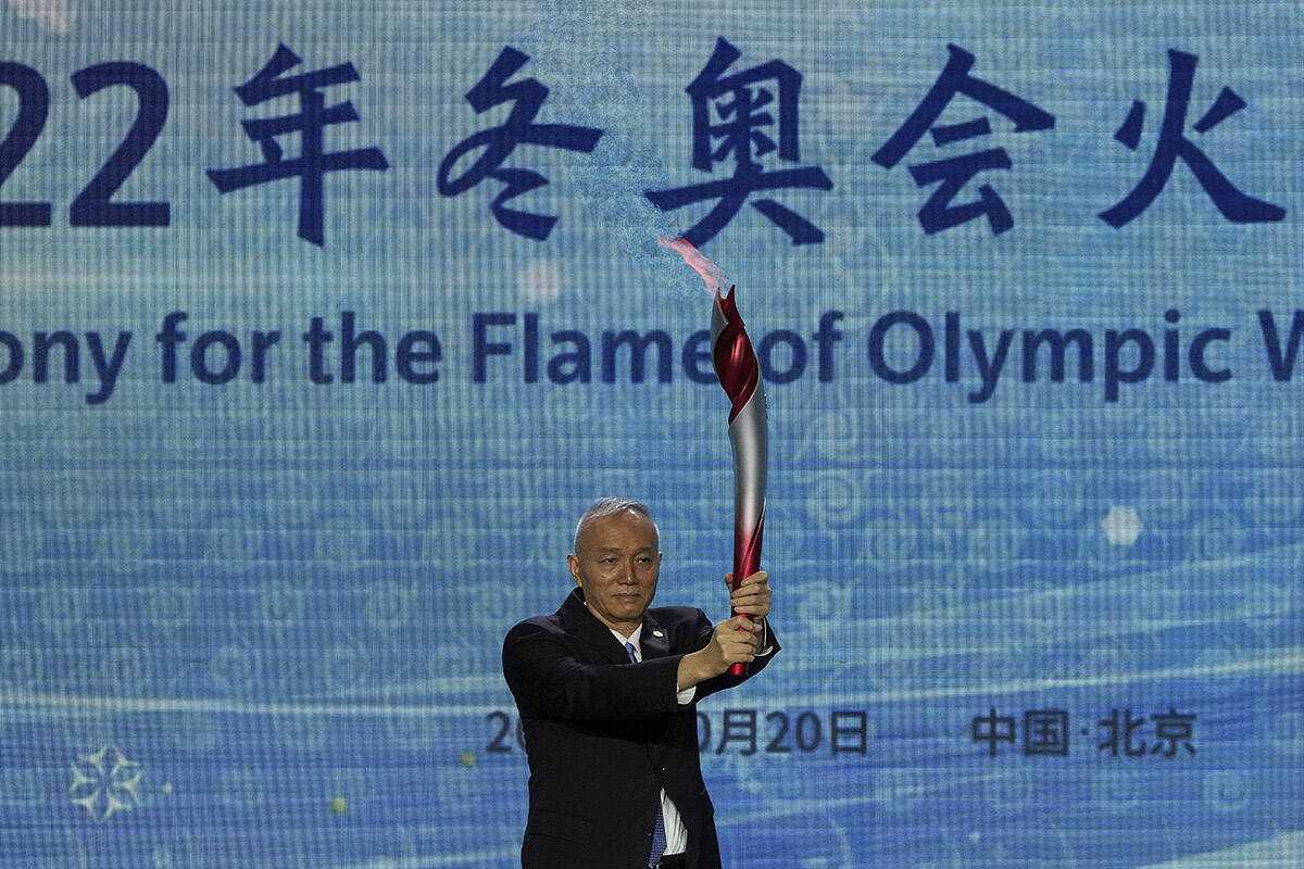 Cai Qi, Beijing Communist Party secretary holds up the Olympic torch during a welcome ceremony for the Frame of Olympic Winter Games Beijing 2022, at the Olympic Tower in Beijing, Wednesday, Oct. 20, 2021. A welcome ceremony for the Olympic flame was held in Beijing on Wednesday morning after it arrived at the Chinese capital from Greece. While the flame will be put on display over the next few months, organizers said a three-day torch relay is scheduled starting February 2nd with around 1200 torchbearers in Beijing, Yanqing and Zhangjiakou. (AP Photo/Andy Wong)