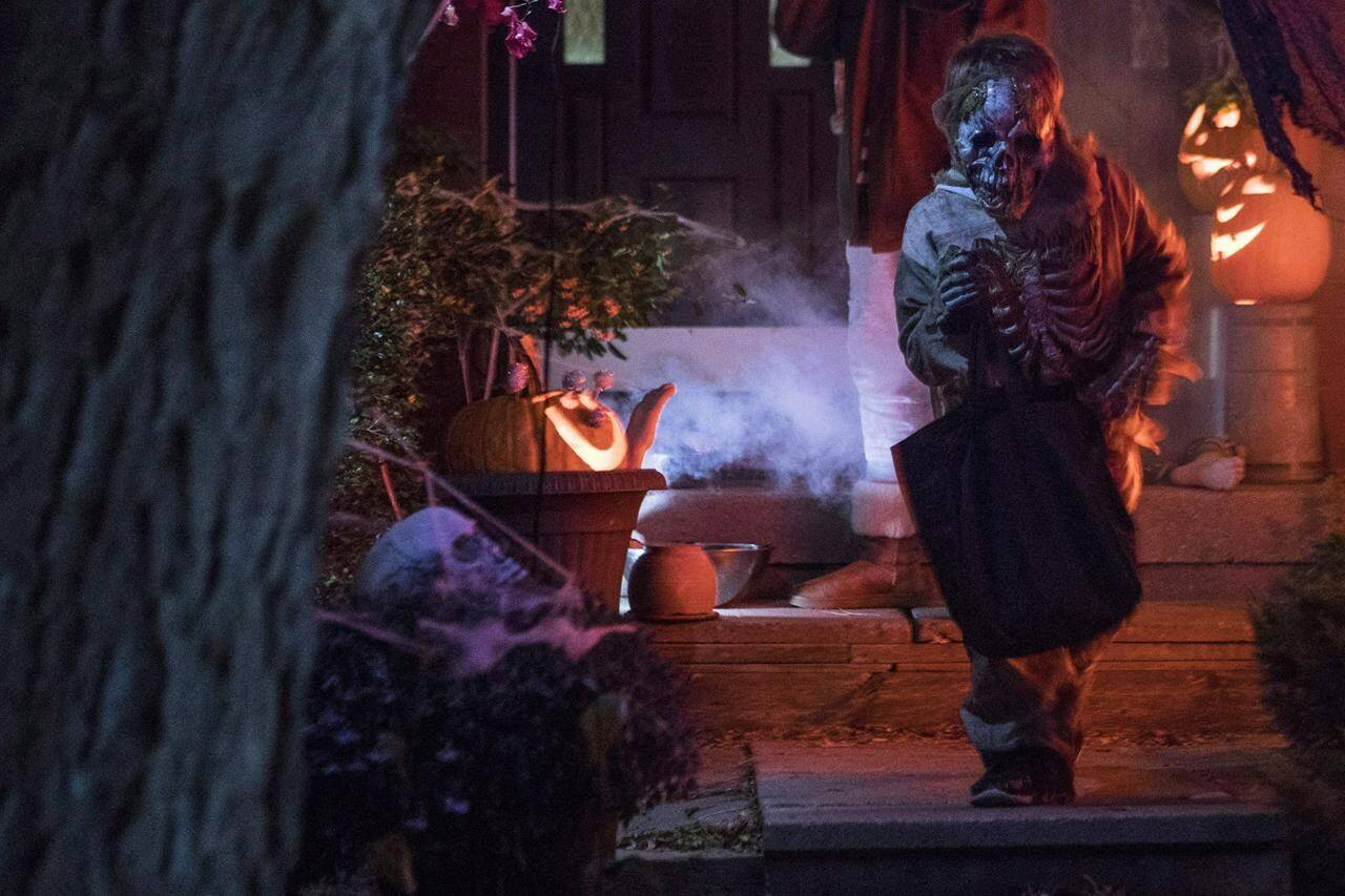 A costumed trick or treater turns after being given candy during Halloween celebrations in Toronto, Tuesday, Oct. 31, 2017. THE CANADIAN PRESS/Chris Young