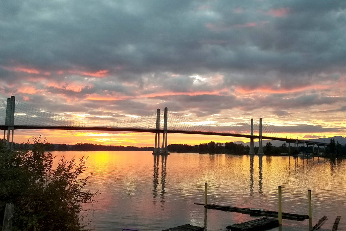 Fort Langley area resident Jodey Schwartz captured a recent sunset that spotlighted the bridge and Pitt Meadows to the north. (Special to Langley Advance Times)