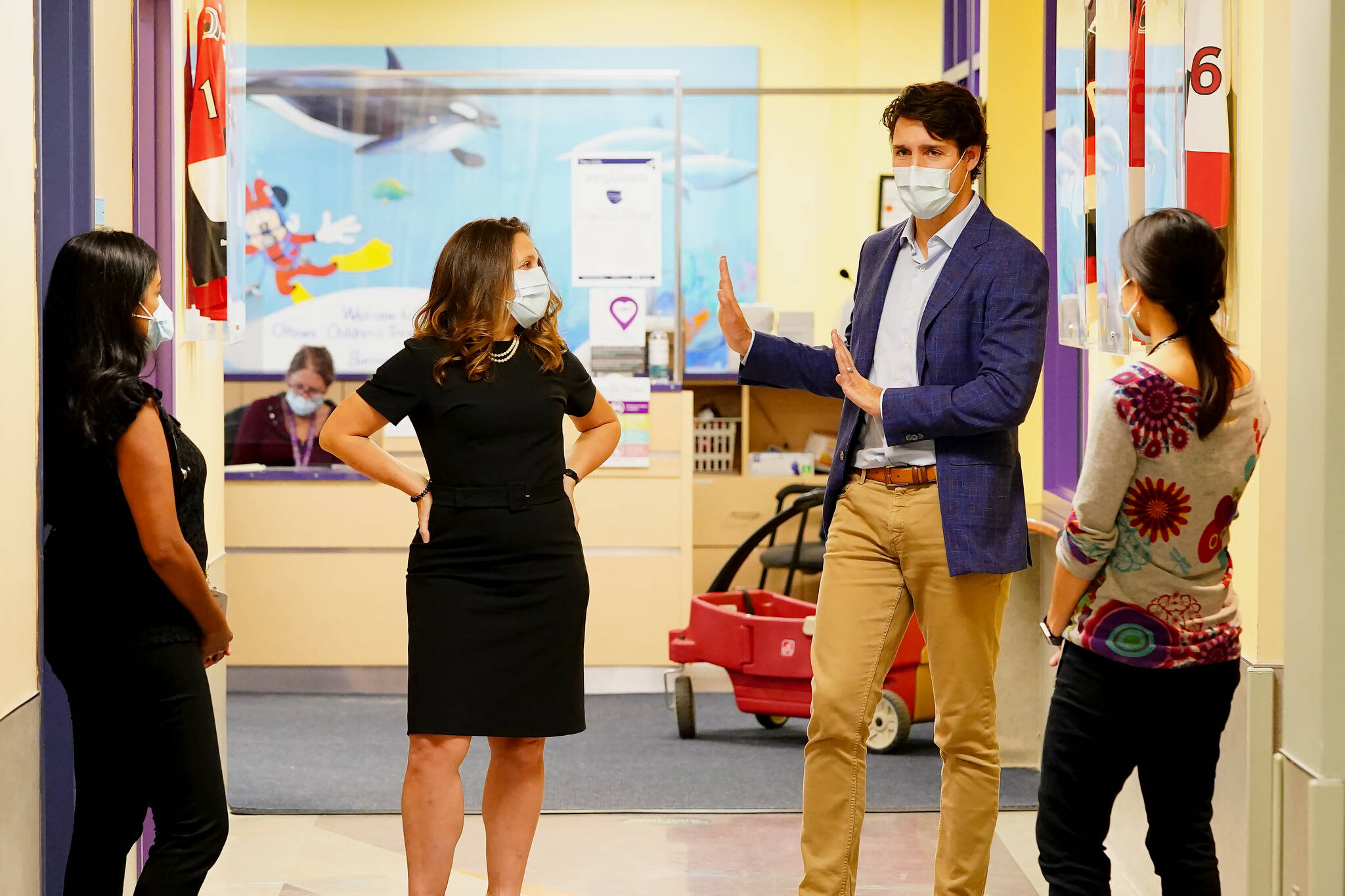 Prime Minister Justin Trudeau and Deputy Prime Minister Chrystia Freeland meet with doctors at the Children's Hospital of Eastern Ontario, in Ottawa, Thursday, Oct. 21, 2021, during a visit to announce Canada's new vaccine passport. THE CANADIAN PRESS/Sean Kilpatrick