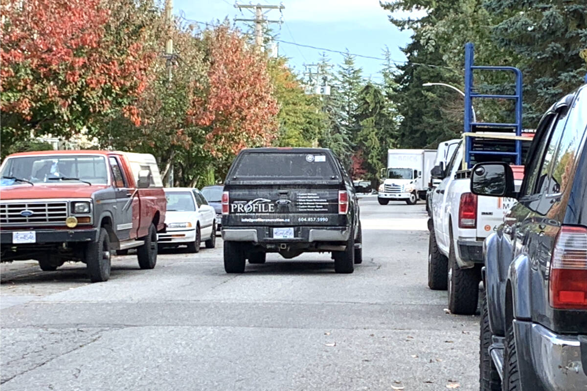 Only one lane of traffic at a time along 54th Avenue, other motorists have to stop or back up. (Langley Advance Times files)