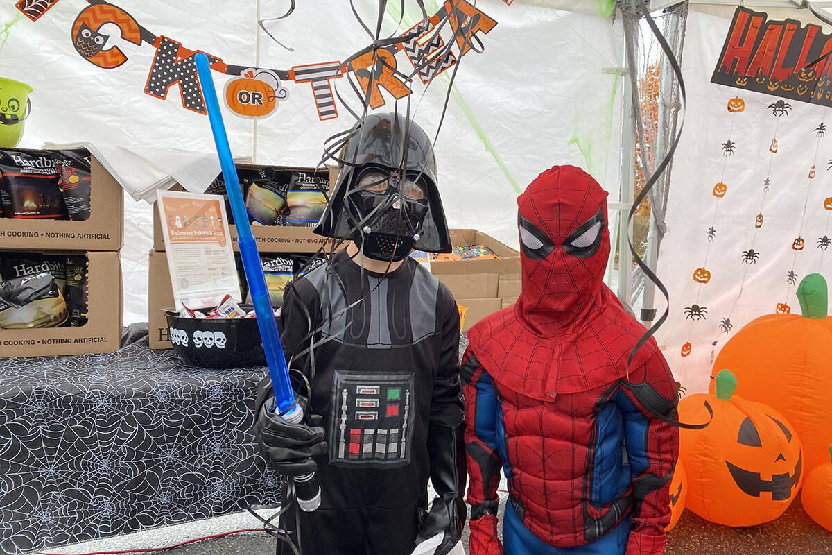 Spider man and Darth vader, picking up their free candy from Aldergrove Shopping Village (Madison McKenzie/Aldergrove Star)