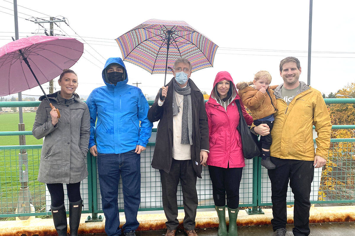 Dr. Brendan Miller with family and friends on the pedestrian overpass on 68th Avenue over 200th St. (Madison McKenzie/Aldergrove Star)