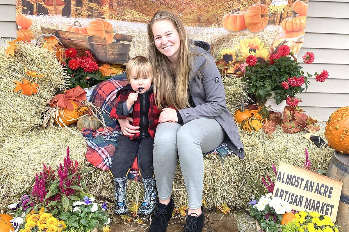 Young Brady enjoying his candy next to his mom (Madison McKenzie/Aldergrove Star)