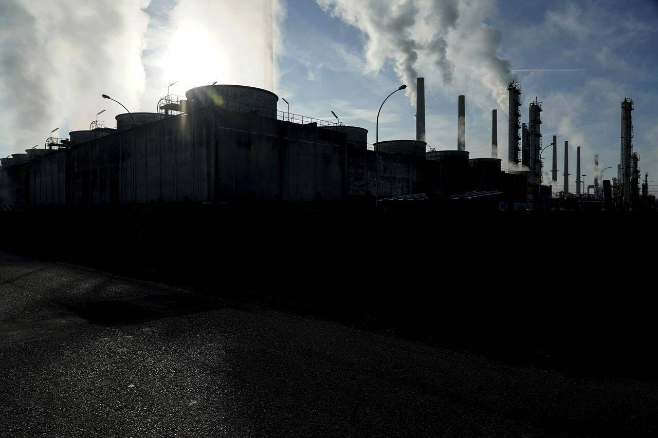 """FILE - In this Oct. 15, 2021 file photo, smoke rises from the Feyzin Total refinery chimneys, outside Lyon, central France. The World Meteorological Organization says greenhouse gas concentrations hit a new record high last year and continued to increase at a faster clip than the average rate in the last decade, despite a temporary blip downward amid coronavirus-linked lockdowns. The U.N. weather agency, releasing its flagship annual report on heat-trapping gases in the atmosphere on Monday Oct. 25, 2021, said concentrations of carbon dioxide, methane and nitrous oxide are all above levels in the pre-industrial era pegged to before 1750, when human activities """"started disrupting Earth's natural equilibrium.""""(AP Photo/Laurent Cipriani, file)"""