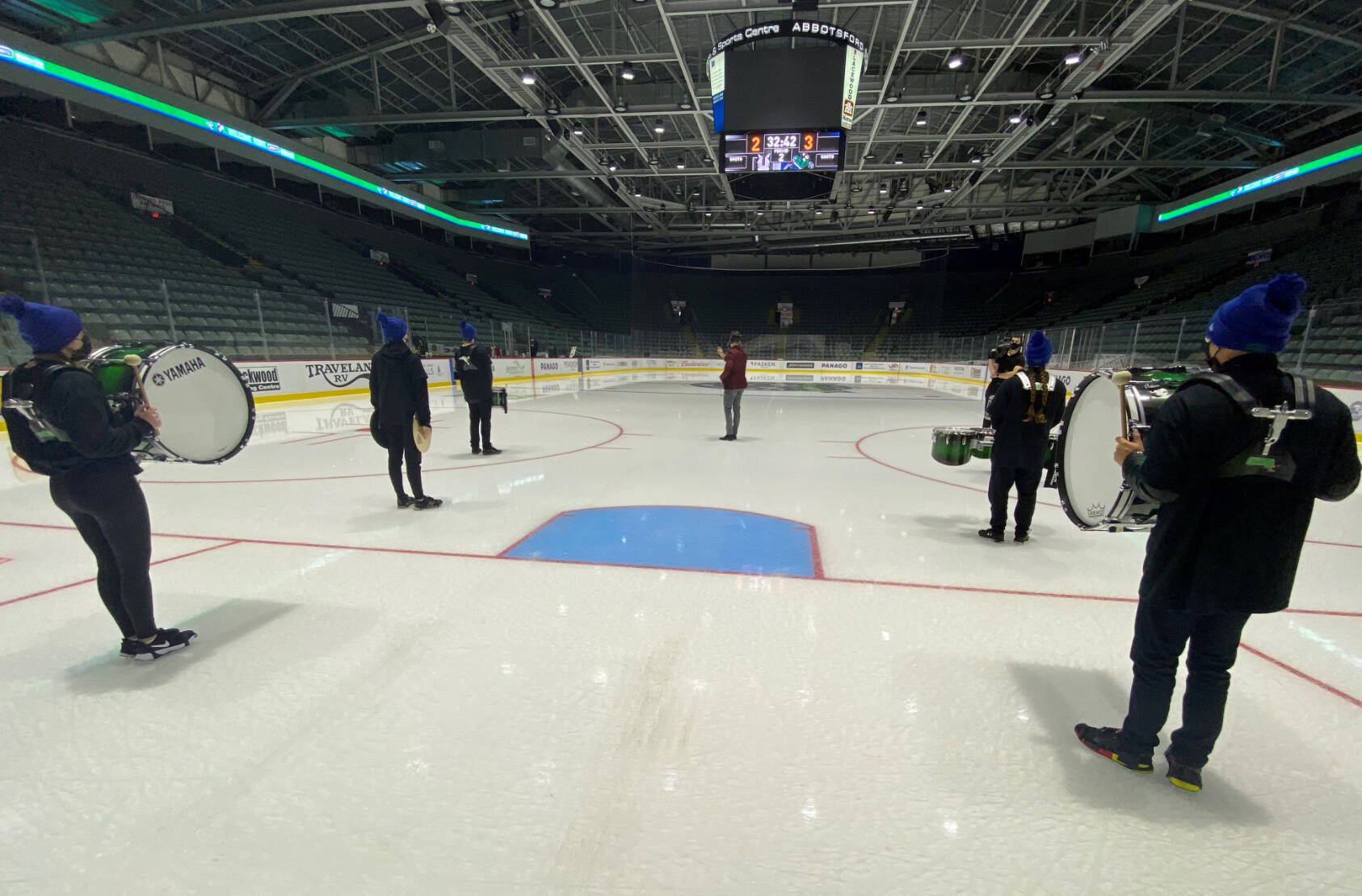 Members of the Sardis Drumline on the ice at an empty Abbotsford Centre prior to Friday night's American Hockey League game. (submitted photo)
