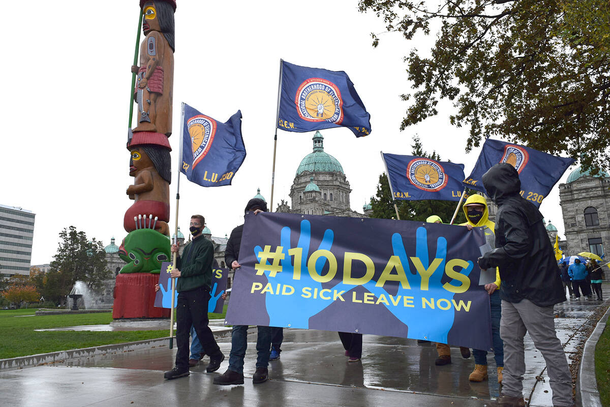 Demonstrators in favour of 10 paid sick leave days march away from the B.C. Legislature in Victoria, doing a lap before ending their demonstration. (Kiernan Green/News Staff)