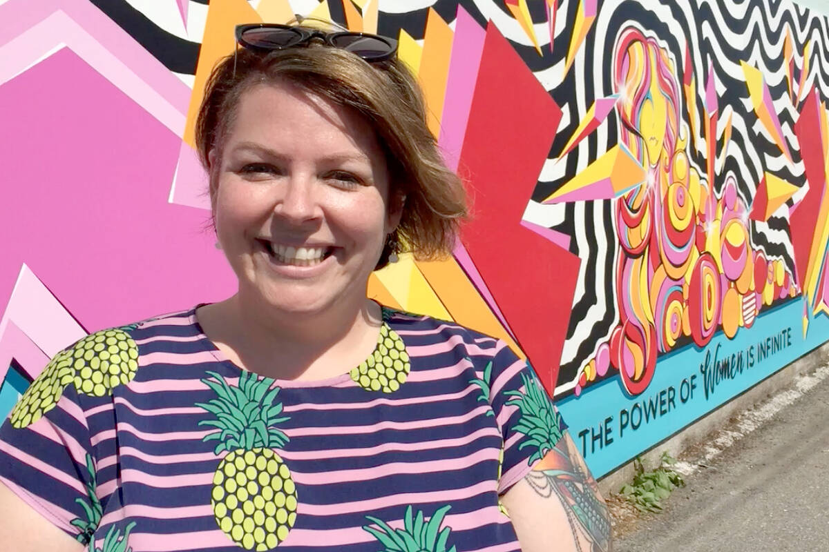 There are a fistful of murals being brought to life in downtown Langley, starting this month. This mural was the first. It's called #thepowerofwomenisinfinite and was painted in 2018 by artist Verna Brown on the back entrance of Forever Yours Lingerie for company owner Sonya Perkins (left). (Langley Advance Times files)